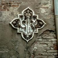 Detail of exterior relief of scuola symbol at Scuola di San Rocco